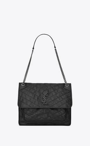 große niki tasche aus schwarzem leder mit knitteroptik und steppnähten
