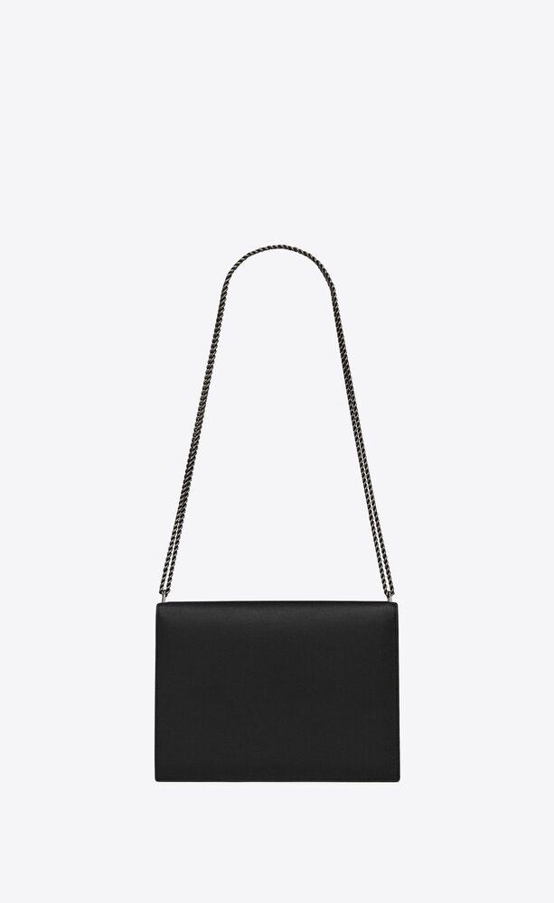 cassandra monogram clasp bag in grain de poudre embossed leather