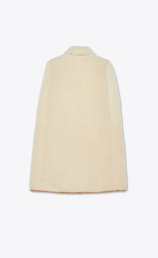buttoned cape in shearling