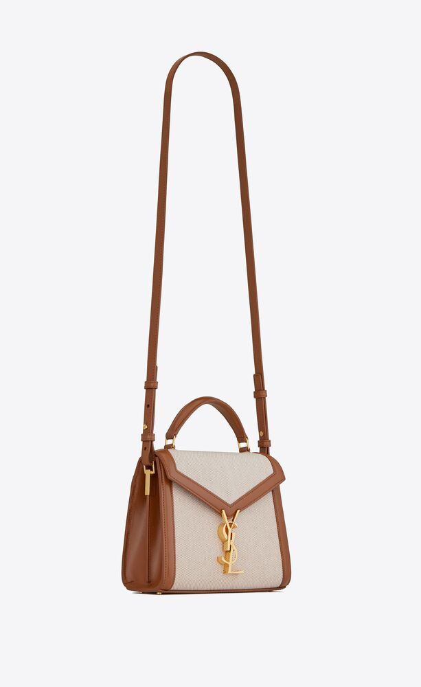 cassandra mini top handle bag in canvas and smooth leather