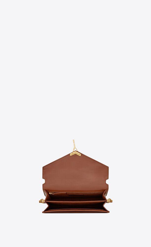 cassandra monogram tasche aus canvas und glattleder mit schnalle