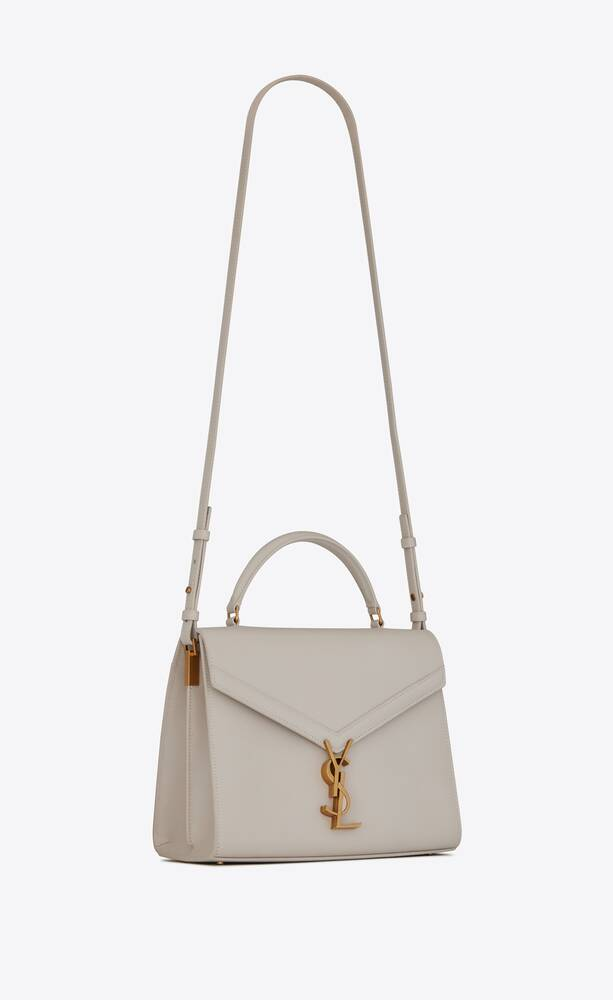 cassandra medium top handle bag in grain de poudre embossed leather