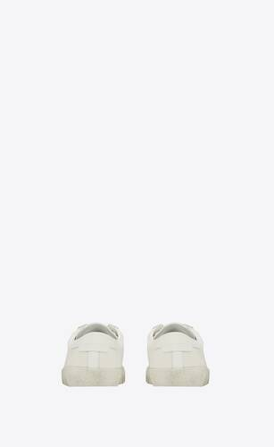 court classic sl/06 sneakers embroidered with saint laurent, in white worn-look fabric and leather