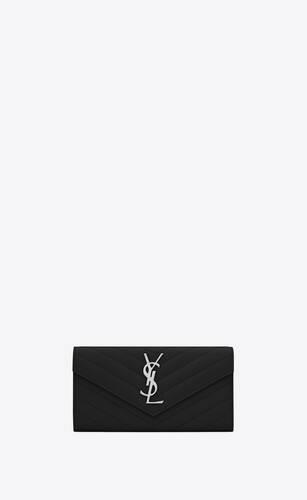 großes saint laurent portemonnaie mit überschlag aus schwarzem matelassé-leder mit struktur