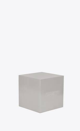 cube-shaped paperweight in steel