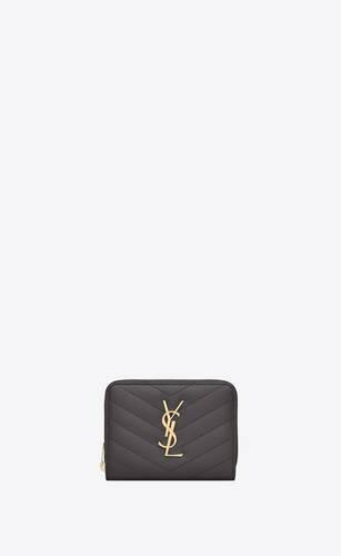 kompaktes portemonnaie mit rundumreißverschluss aus schwarzem matelassé-leder mit struktur