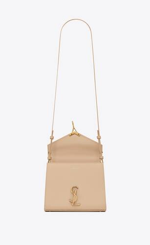 cassandra mini top handle bag in grain de poudre embossed leather