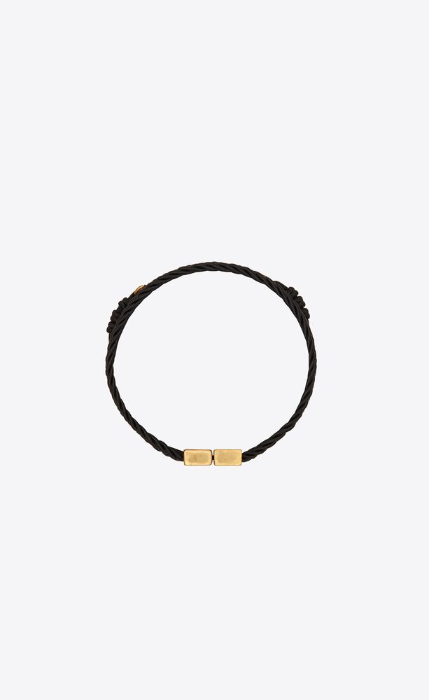 passementerie and curb-chain bracelet