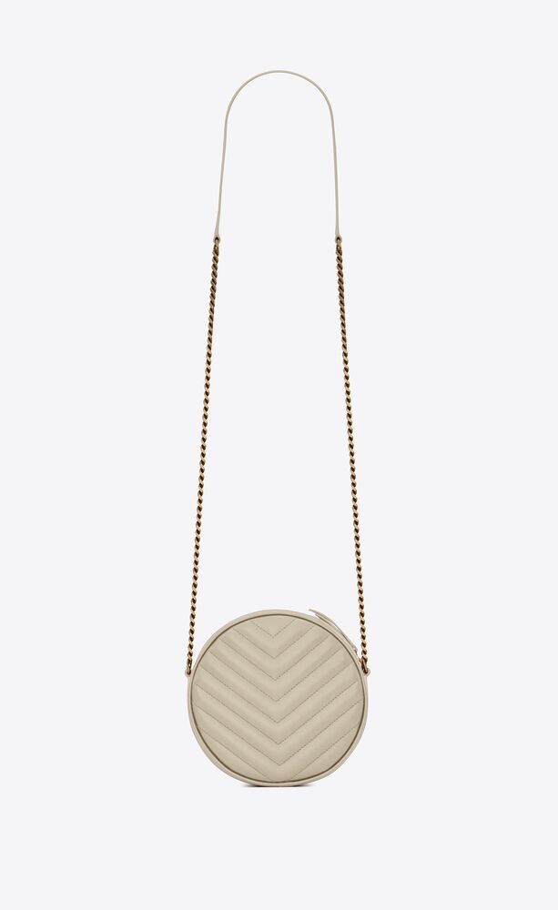 vinyle round camera bag in chevron-quilted grain de poudre embossed leather