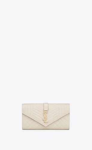 large flap wallet in grain de poudre embossed leather