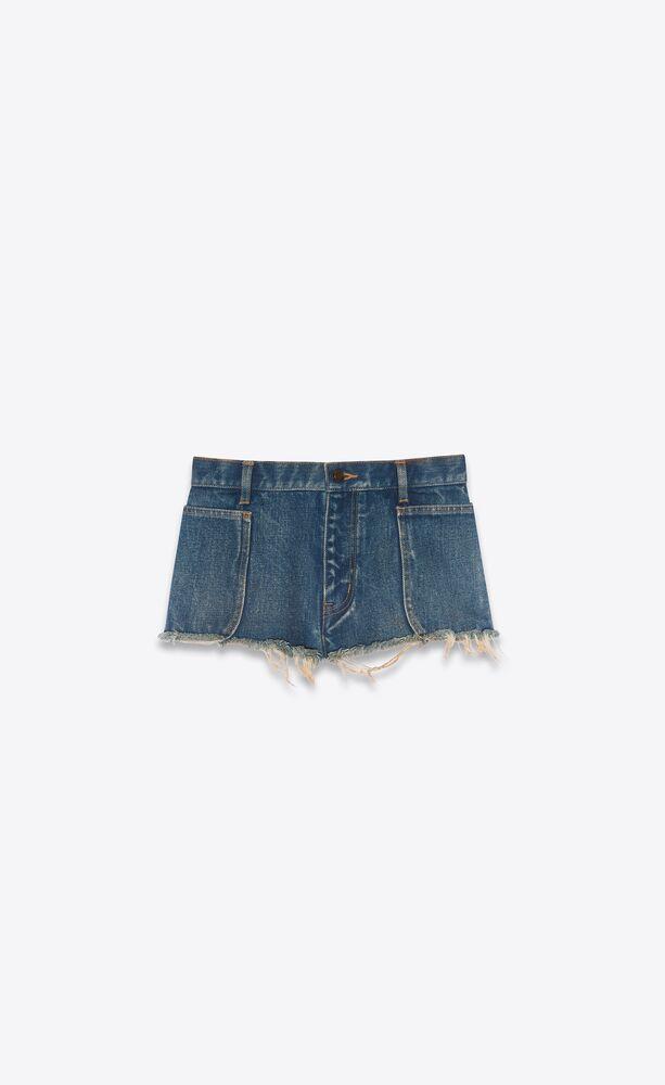 pantalones cortos de denim azul índigo con bordes en bruto
