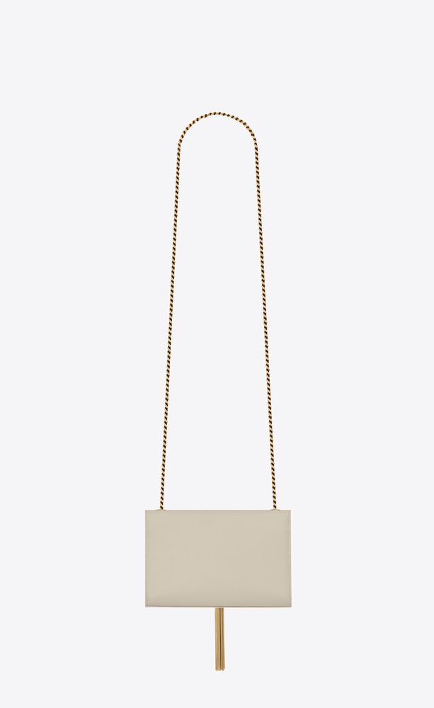 kate small bag with tassel in grain de poudre embossed leather