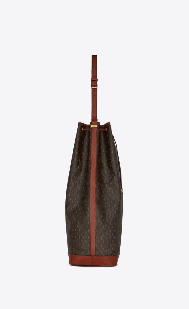 le monogramme long bucket bag in canvas and smooth leather