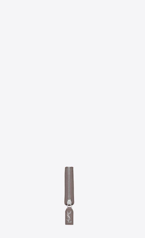 rive gauche portemonnaie mit rundumreißverschluss mit -signatur an schlaufe aus nebelgrauem narbenleder