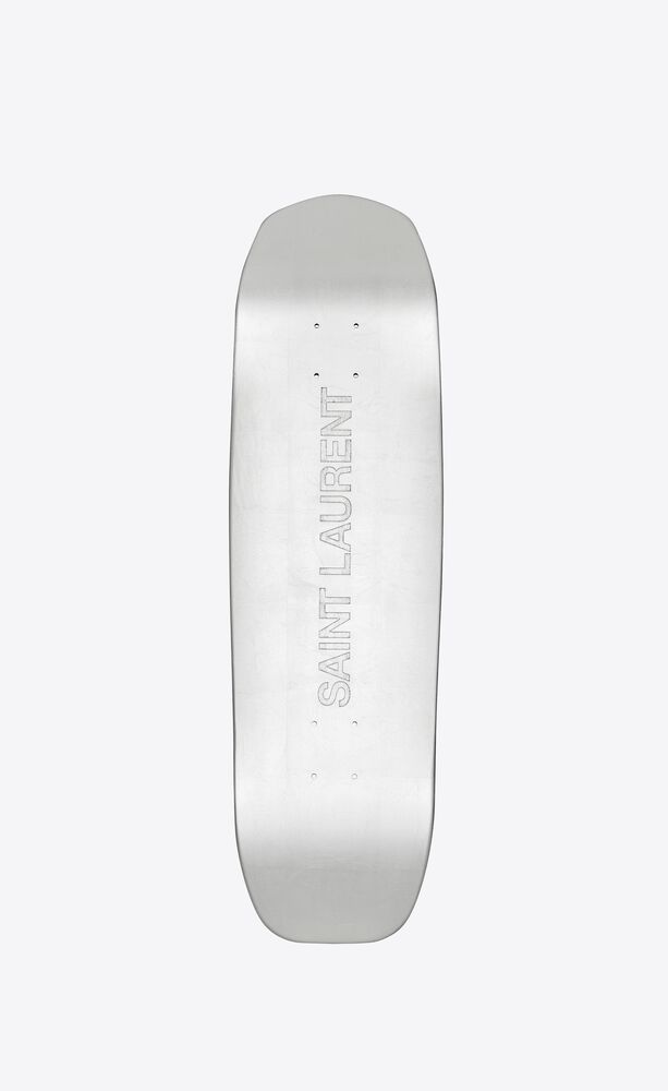 saint laurent skateboard covered with silver leaves
