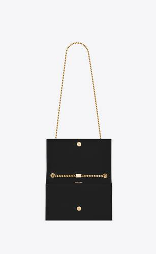 kate medium bag with tassel in grain de poudre embossed leather