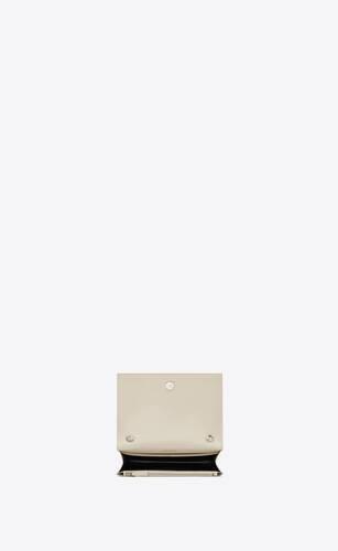 kate chain wallet avec pompon en cuir embossé crocodile