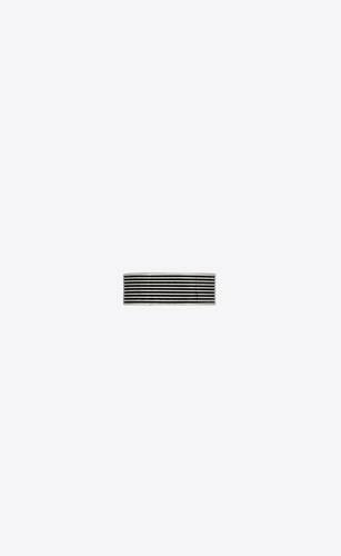 large striped ring in metal