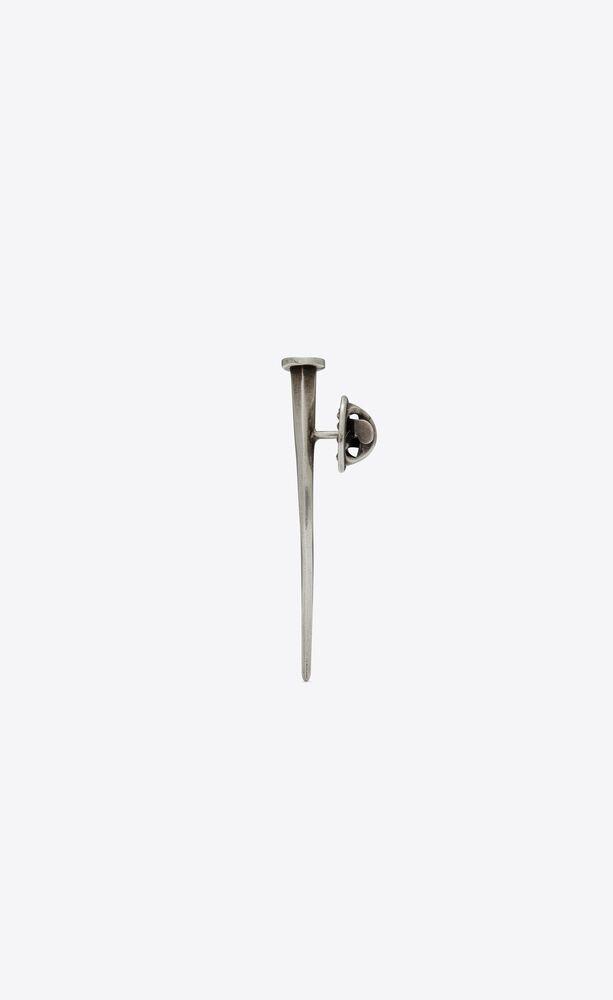 nail brooch in metal