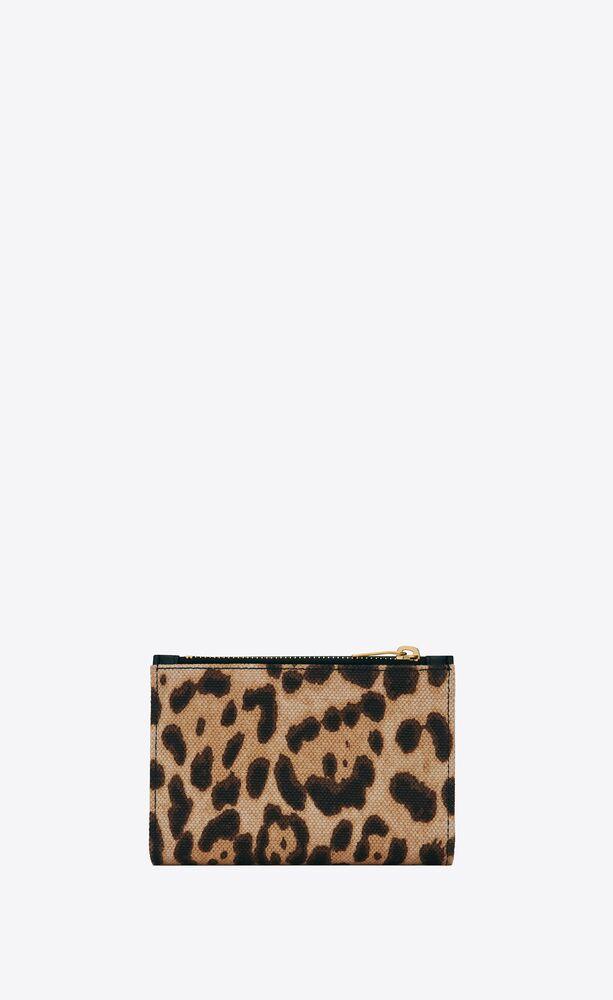 monogramme portefeuille à deux volets en cuir lisse et toile à imprimé léopard