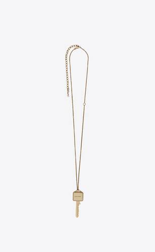charms pendant in light gold metal