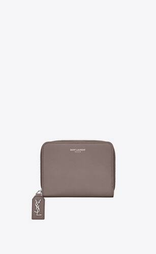 rive gauche compact zip around wallet in grained leather