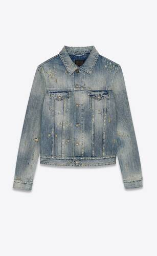 destroyed jean jacket in repaired dirty blue denim
