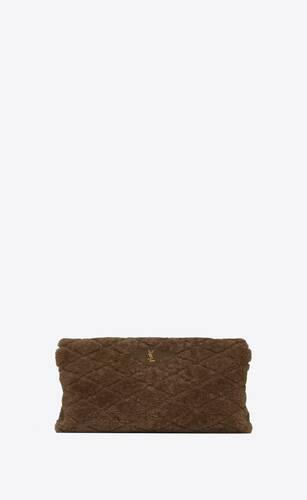 sade puffer envelope clutch in  shearling