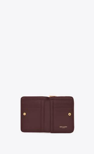 monogram compact zip around wallet in grain de poudre embossed leather