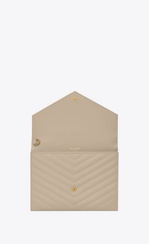 monogram clutch in quilted grain de poudre embossed leather
