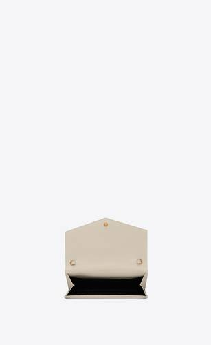 uptown chain wallet in grain de poudre embossed leather