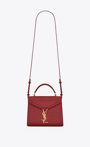 cassandra mini top handle bag in crocodile-embossed leather