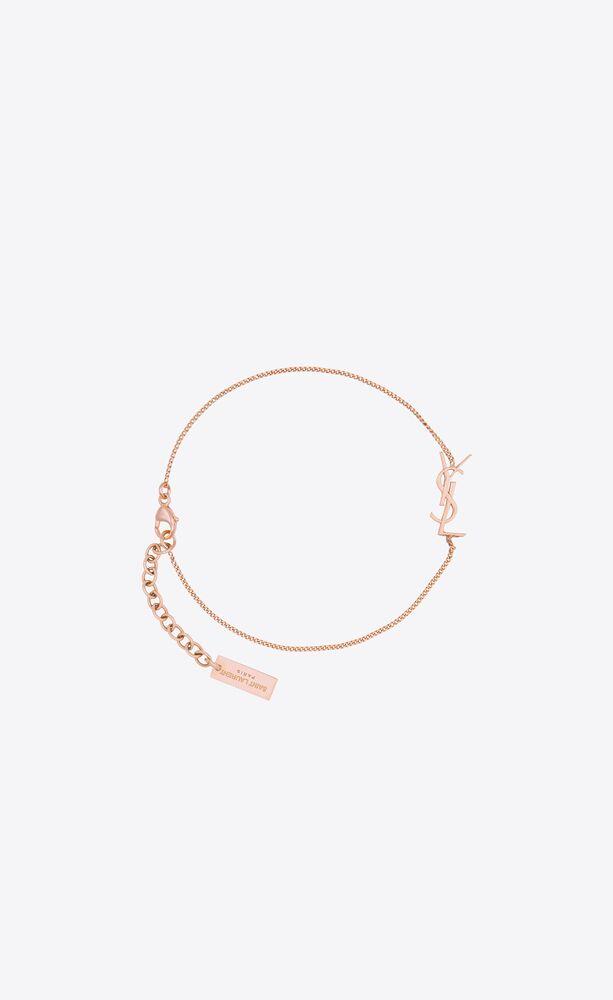 bracciale in metallo con charm opyum