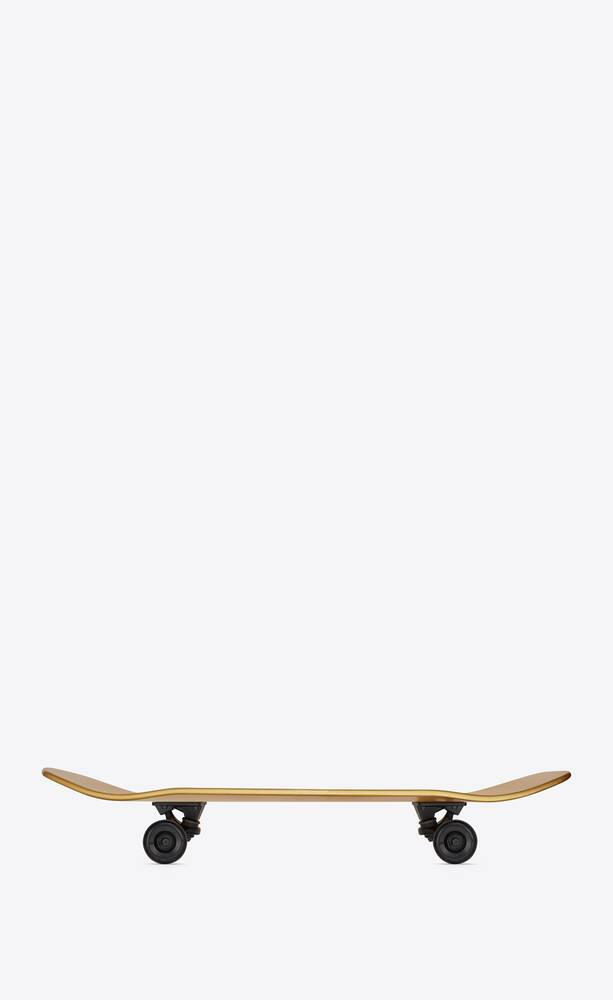 saint laurent skateboard covered with gold leaves
