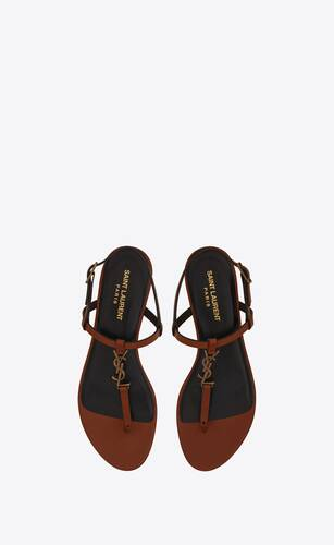 cassandra flat sandals in leather with gold-tone monogram