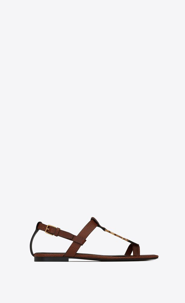 cassandra flat sandals in lizard-embossed shiny leather with bronze-tone monogram