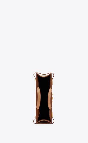 코튼 캔버스와 빈티지 가죽 소재의 맨하탄 스몰 쇼퍼백