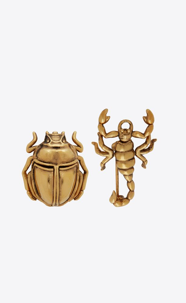 scorpion and beetle brooches in metal