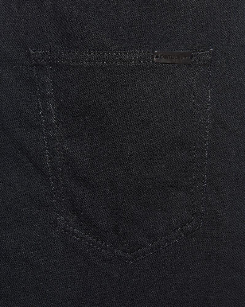 vaqueros pitillo de denim stretch negro con efecto enlucido plateado