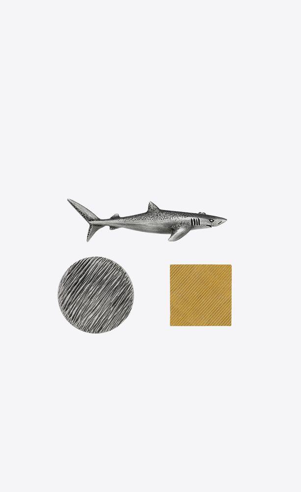 shark and circular pins in metal