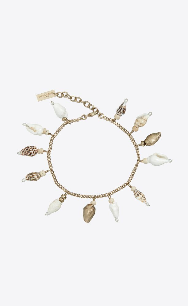 seashell charm bracelet in metal, shells and wood
