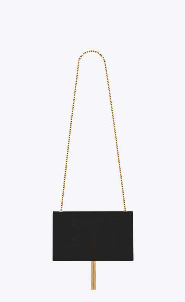 bolso kate medium con borla de piel repujada grain de poudre