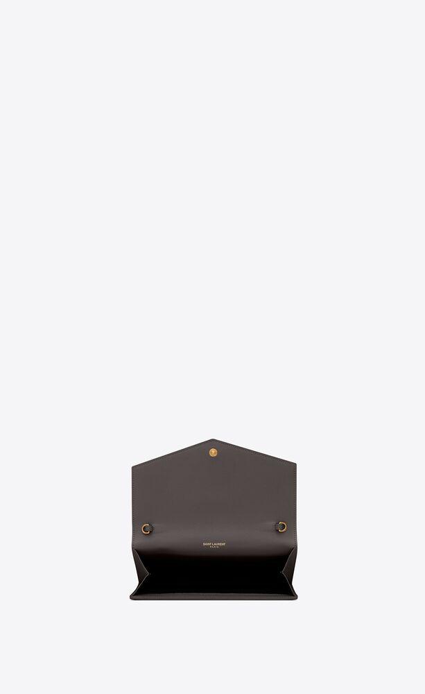uptown chain wallet in grain de poudre embossed leather