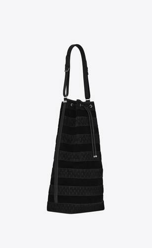 le monogramme long bucket bag in suede and vegetable-tanned leather